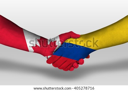 Handshake between columbia and canada flags painted on hands, illustration with clipping path.
