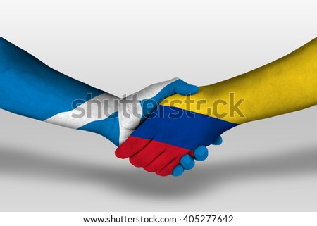 Handshake between columbia and scotland flags painted on hands, illustration with clipping path.