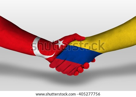Handshake between columbia and turkey flags painted on hands, illustration with clipping path.