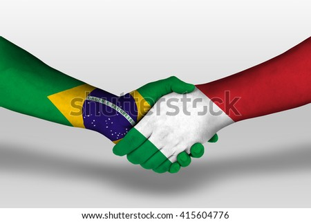 Handshake between italy and brazil flags painted on hands, illustration with clipping path. - stock photo