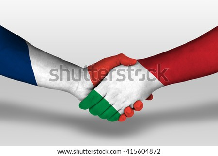 Handshake between italy and france flags painted on hands, illustration with clipping path. - stock photo
