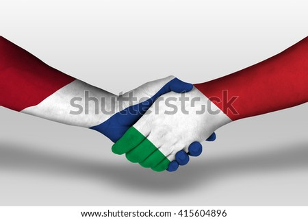 Handshake between italy and netherlands flags painted on hands, illustration with clipping path. - stock photo