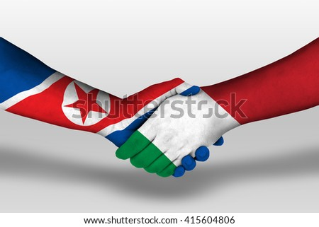 Handshake between italy and north korea flags painted on hands, illustration with clipping path. - stock photo