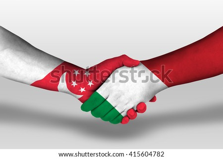 Handshake between italy and singapore flags painted on hands, illustration with clipping path. - stock photo