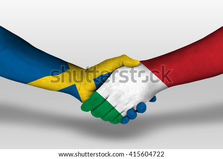 Handshake between italy and sweden flags painted on hands, illustration with clipping path. - stock photo
