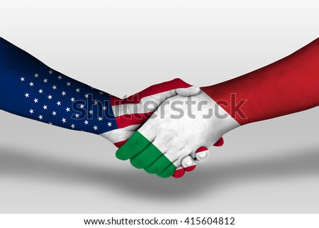 Handshake between italy and united states of america flags painted on hands, illustration with clipping path. - stock photo