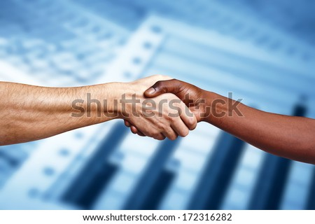 Handshake between multiracial people - stock photo