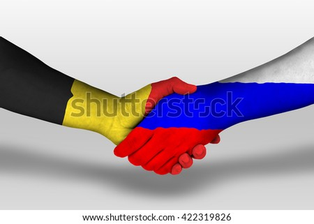 Handshake between russia and belgium flags painted on hands, illustration with clipping path.