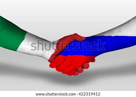 Handshake between russia and italy flags painted on hands, illustration with clipping path. - stock photo