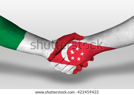 Handshake between singapore and italy flags painted on hands, illustration with clipping path. - stock photo