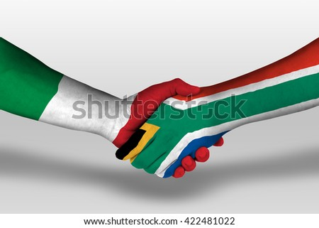 Handshake between south africa and italy flags painted on hands, illustration with clipping path. - stock photo