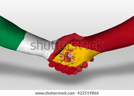 Handshake between spain and italy flags painted on hands, illustration with clipping path. - stock photo