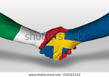 Handshake between sweden and italy flags painted on hands, illustration with clipping path. - stock photo