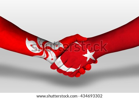 Handshake between turkey and hong kong flags painted on hands, illustration with clipping path.