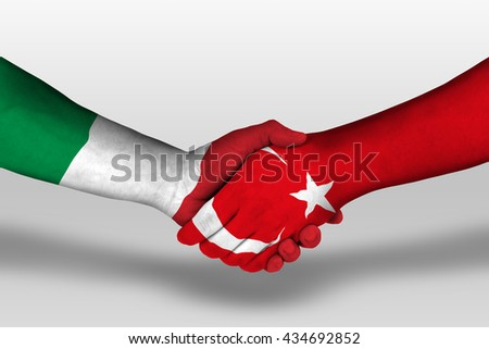 Handshake between turkey and italy flags painted on hands, illustration with clipping path. - stock photo