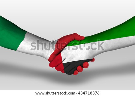 Handshake between united arab emirates and italy flags painted on hands, illustration with clipping path. - stock photo
