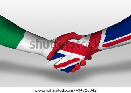 Handshake between united kingdom and italy flags painted on hands, illustration with clipping path. - stock photo