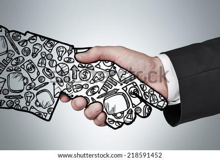 Handshake, drawn hand and businessman's hand. - stock photo