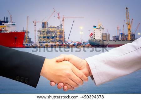 Handshake port construction agreement logistics partners stock photo handshake port construction agreement logistics partners stock photo royalty free 450394378 shutterstock platinumwayz