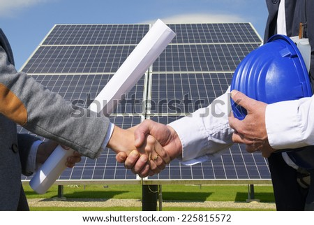 Handshake for solar panel - stock photo