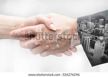 Handshake in business,  double exposure - stock photo