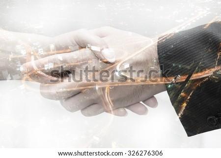 Handshake in business,  double exposure - stock photo