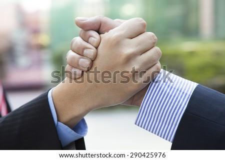 Handshake in the city - stock photo