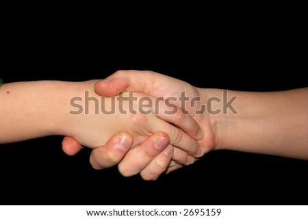 Handshake isolated on black - stock photo