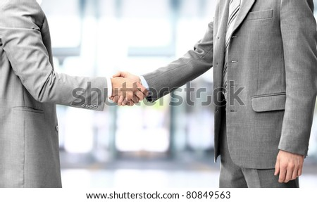 handshake isolated on blue background - stock photo