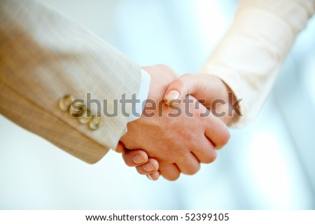 Handshake of business partners after signing contract - stock photo