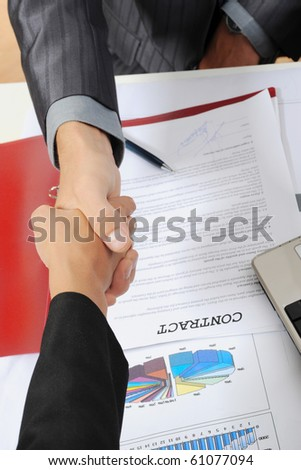 Handshake of business partners, when signing contract. - stock photo