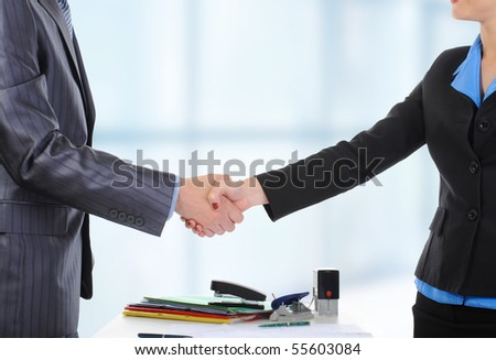 Handshake of business partners, when signing documents. - stock photo
