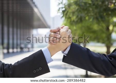 Handshake of business people outside - stock photo
