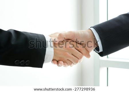Handshake of businessmen -  greeting,dealing & partnership concepts - stock photo