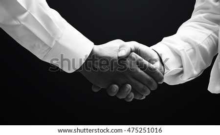 Handshake of businessmen, greeting, dealing, partnership, merger & acquisition concepts - monochrome effect The cross, Jesus, Christian, Christ, forgiveness, cooperation, gentle, Bible, church,
