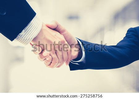 Handshake of businessmen - vintage tone - stock photo