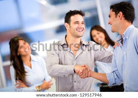 Handshake of two business men closing a deal at the office - stock photo