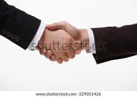 handshake of two businessmen fore - stock photo