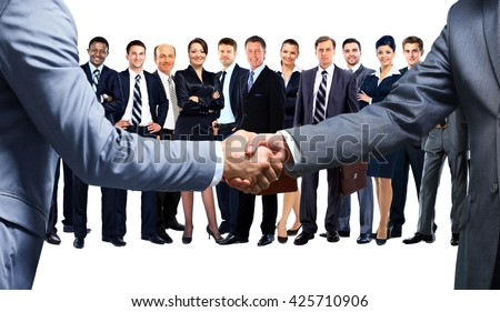 handshake of two businessmen in office - stock photo