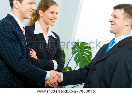 Handshake of two successful partners at business meeting - stock photo