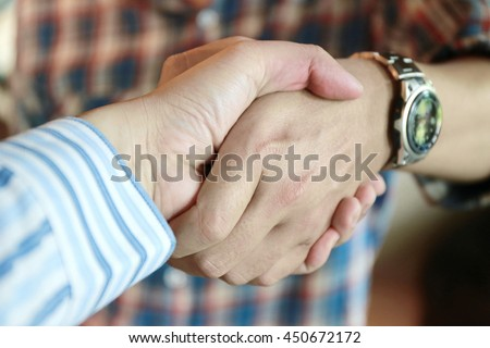 Handshake of two young businessmen, Business handshake and business people. Business handshake for closing the deal after contract between companies. Good business partner trust and relationship. - stock photo
