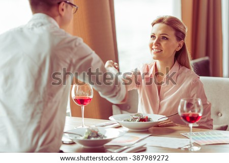 https://thumb9.shutterstock.com/display_pic_with_logo/2181548/387989272/stock-photo-handshake-of-young-business-man-and-woman-during-business-meeting-at-the-restaurant-387989272.jpg