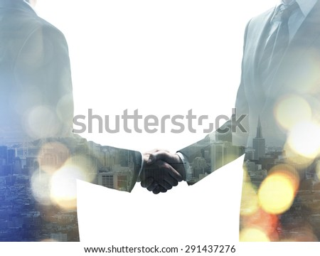handshake on a modern building background - stock photo