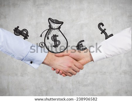handshake on a money sign background - stock photo