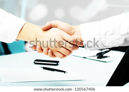 handshake on a office background