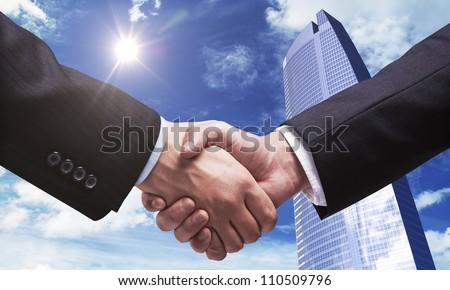 handshake on  background of skyscraper - stock photo