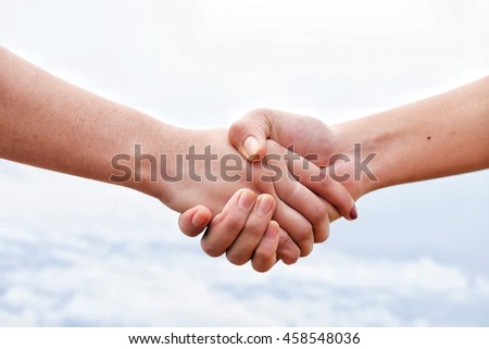 handshake  on white sky and cloud
