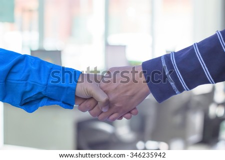 handshake or Businessmen  blur in the workplace - stock photo