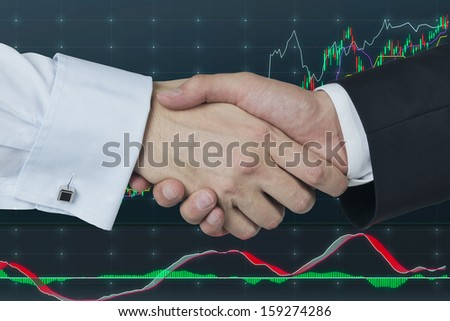 Handshake over stock market chart - stock photo