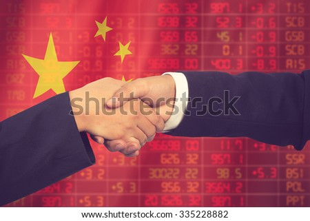 Handshake over stock market chart Flag of China.Downtrend stock - stock photo